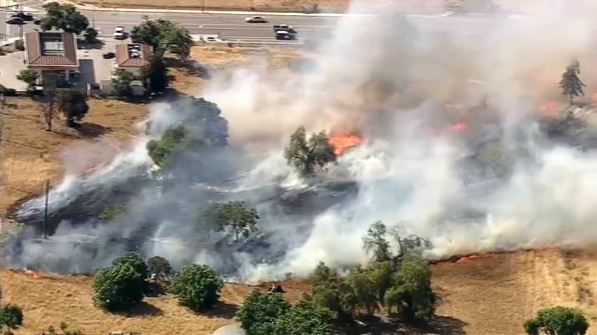 A brush fire burns near downtown San Jose and Mineta San Jose International Airport.