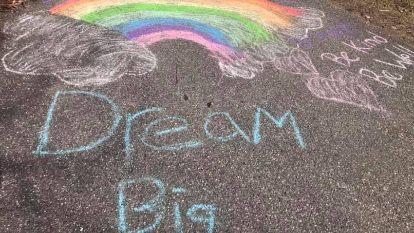 Photos of chalk messages on driveways