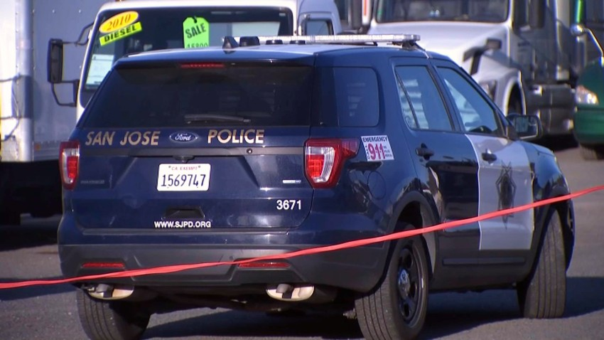 A San Jose police car at the scene of a deadly collision involving a juvenile.