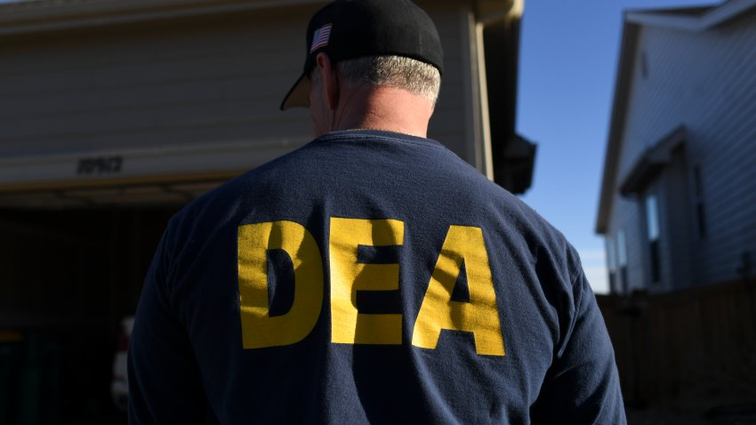 In this file photo, a DEA agent is seen in Commerce City, Colorado - January 31, 2019.