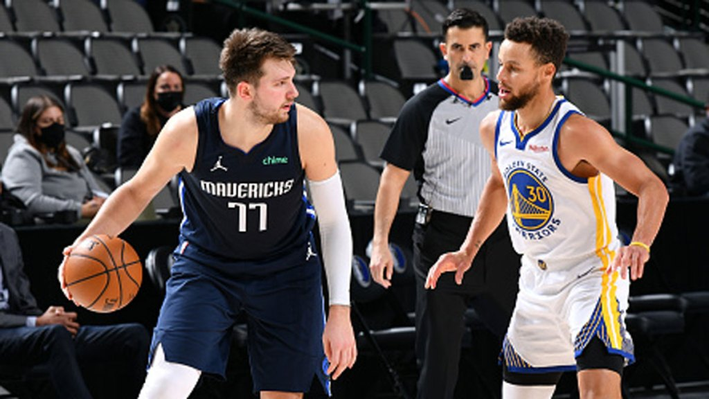 Luka Doncic #77 of the Dallas Mavericks dribbles the ball against Andrew Wiggins #22 of the Golden State Warriors on Feb. 6, 2021 at the American Airlines Center in Dallas, Texas.