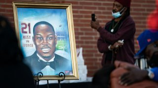 A painting of Ahmaud Arbery is displayed during a vigil at New Springfield Baptist Church