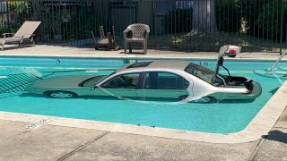 A car ends up in a pool in San Jose following a crash.