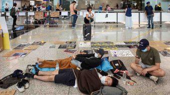 Hong Kong: reanudan vuelos; manifestantes se disculpan